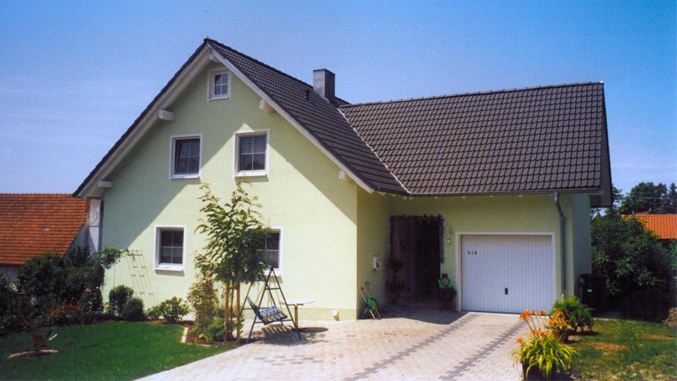 Einfamilienhaus mit integrierter garage  Trathnigg Planungsgruppe
